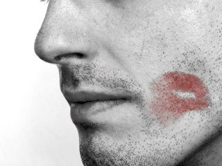 man with lipstick smudge